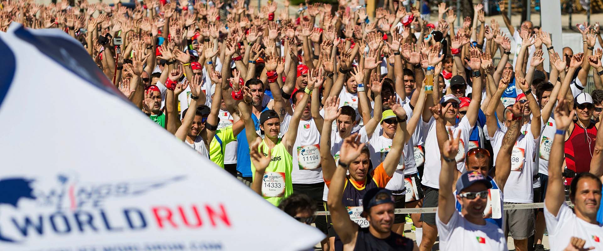 Participants warm up before the race at the Wings For Life World Run in Comporta, Portugal, on May 4, 2014 // Goncalo Barriga for Wings for Life World Run // P-20140506-00200 // Usage for editorial use only // Please go to www.redbullcontentpool.com for further information. //